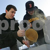 Salem: Salem native, Adam Walsh, left, and his long-time friend, Chris Polakiewicz of Salem, frequently collaborate to make home brew beers of many different styles. Here, Walsh works to stir the malt as Polakiewicz adds hot water during the mashing process of Polakiewicz's American amber ale. Photo by Matthew Viglianti/Staff Photographer Monday, February 9, 2009.