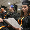 Erika Pisa reads her program at Beverly High School's graduation on Sunday.