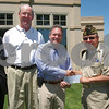 Salem: From left to right, Jean-Guy Martineau, VFW Post Quartermaster, Mike Finn, president of Kernwood Country Club, Bob Ogan, chairman of the Jewish Federation Tournament, Richard LaPointe, VFW Post Commander, and Irving Weisman, past chairman of the Jewish Federation Tournament, pose at Kernwood Country Club in Salem, where the officers of the Jewish Federation Tournament donated $47,500 to the Witch City Post VFW to help the sick, needy and elderly veterans, and for men and women currently serving in the armed forces, on Monday afternoon. Photo by Matthew Viglianti/Staff Photographer Monday, May 25, 2009.