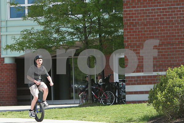 Marblehead: Jeremy Rubin, a freshman at Marblehead High School has been riding a unicycle for three years, and uses it to commute the one mile to and from school and to ride off-road on trails through the woods. Photo by Matthew Viglianti/Staff Photographer Tuesday, May 26, 2009.