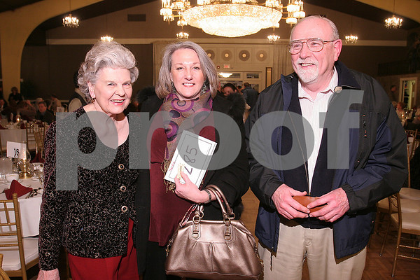Danvers: From left, Joanne Patton, Kyle Roberte, and Martin Walsh pose at a fundraising party hosted by Save our Theatre, to raise money to keep the North Shore Music Theatre open. Photo by Matthew Viglianti/Staff Photographer Tuesday, February 3, 2009.