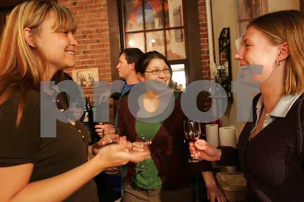 Salem: From left, Rebecca Matthews and Maria Castro from Salem talk with Heather Moore from Melrose at a weekly wine tasting at Salem Wine Imports on Tuesday night. Many regular guests at the tastings have gotten to know each other and become friends while sampling different wines from the store's collection. Photo by Matthew Viglianti/Staff Photographer Tuesday, April 7, 2009.