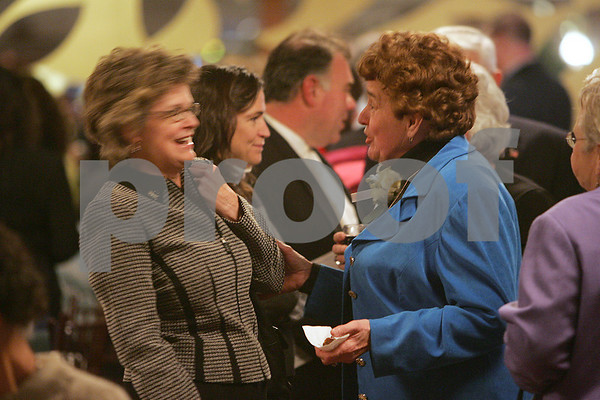 Danvers: Janice Tipert, right, jokes with her friend Chris Crowley of Danvers at a Danvers Education Enrichment Program ceremony honoring Tipert, David Joyce, and Dan Bennett on Thursday. Photo by Matthew Viglianti/Staff Photographer Thursday, November 20, 2008.