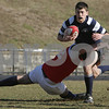 Danvers: St. John's Prep sophomore Brian Garey carries the ball for the Eagles while Matthew Freund dives to make the tackle during the Prep's home rugby match against Lincoln-Sudbury on Tuesday. Photo by Matthew Viglianti/Staff Photographer Tuesday, March 31, 2009.