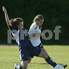 Beverly: Swampscott senior captain Skylar Sabbag slides in to steal the ball from Beverly freshman Sky Cowans during the first half of Swampscott's game in Beverly on Tuesday. After a first half that ended 1-1, Swampscott broke the game open in the second half and won 5-2. Photo by Matt Viglianti/Salem News Tuesday, October 07, 2008