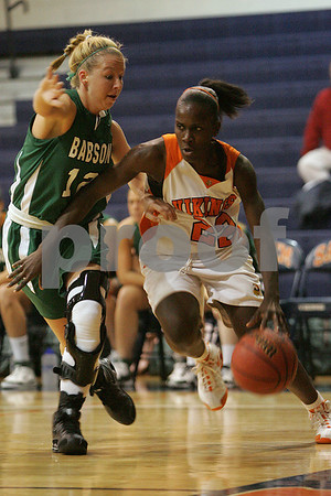 Salem: Salem State junior forward Manise Louinord, right, drives the baseline against Babson sophomore Amanda Grammel during the teams' game in Salem on Monday. Photo by Matthew Viglianti/Staff Photographer Monday, December 8, 2008.