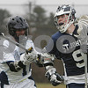 Peabody: John Jennings from St. John's Prep, right, turns the corner against Peabody's Antonio Capela while carrying the ball upfield for the Eagles during their away game at Peabody on Wednesday afternoon. Jennings netted seven goals for the Prep, who won the game 17-4. Photo by Matthew Viglianti/Staff Photographer Wednesday, April 1, 2009.