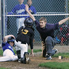 Beverly: Spencer Akerman from the Dodgers, left, slides safely into home under a tag from the Pirates' Max Armbruster during their Beverly Little League game at Harry Ball Field on Thursday. Photo by Matthew Viglianti/Staff Photographer Thursday, April 29, 2010.