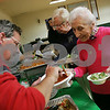 Salem: Joseph Panzner serves eggplant to Margaret Celona of Peabody during an Italian Heritage Dinner at the Christopher Columbus Society in Salem, where members of Veturia Romana Mixed Lodge 1200 gathered on Monday for a monthly meeting and celebration of Italian Heritage Month. Photo by Matt Viglianti/Salem News Monday, October 06, 2008