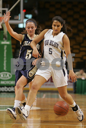 Boston: Swampscott senior Tara Nimkar dribbles past Archbishop Williams freshman Michaela Flanagan during the first quarter of their teams' Division 3 state tournament semifinal game at the TD Banknorth Garden in Boston on Monday. Swampscott won the game 67-51 to advance to the Division 3 title game at the DCU Center in Worcester on Saturday. Photo by Matthew Viglianti/Staff Photographer Monday, March 9, 2009.