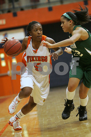Salem: Salem State junior Jakoya Wilkins, left, pushes past Babson sophomore Becky Bowman during the first half of the teams' game in Salem on Monday. Photo by Matthew Viglianti/Staff Photographer Monday, December 8, 2008.