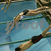 Marblehead: Swimmers spring into the water at the start of the 50 yard individual freestyle race at a meet between Marblehead and Swampscott on Monday evening. Photo by Matt Viglianti/Salem News Monday, December 22, 2008