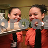Peabody: Twin sisters Joselin, left, and Roselin Sanz of Peabody have worked together at Brooksby Village in Peabody for about one year. Over 260 area students work at the Retirement Community, including 19 sets of siblings. Photo by Matthew Viglianti/Staff Photographer Thursday, February 26, 2009.