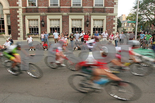 Salem: Cyclests speed around Salem Common past the Hawthorne Hotel and a group of spectators during the Women's race of the Witches Cup in Salem on Wednesday. Photo by Matt Viglianti/Salem News Wednesday, August 13, 2008
