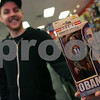 Peabody: Justin Buzzell from Peabody, a shift manager at Newbury Comics in Peabody, holds a Barack Obama action figure being sold in the store on Sunday afternoon. Photo by Matthew Viglianti/Staff Photographer Sunday, January 18, 2009.