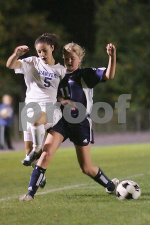 Danvers: Swampscott junior Mallory McDonough, right, bumps Danvers junior Joanna Zecha off the ball during the second half of the Big Blue's away game in Danvers on Wednesday. Photo by Matt Viglianti/Salem News Wednesday, October 15, 2008