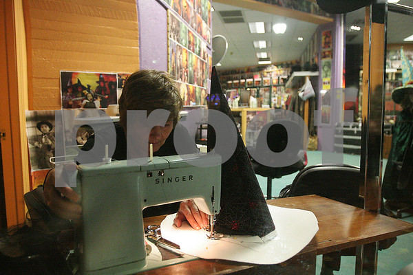 Salem: Rita Tolan works on a sewing machine to repair pointed witch hats after hours at Salem Vintage Photography on Wednesday night. Cold weather and rain kept Halloween tourists out of the Witch City yesterday, but local business are hoping the holiday weekend will draw huge crowds. Photo by Matthew Viglianti/Staff Photographer Wednesday, October 28, 2009.