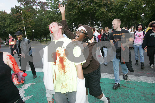 Salem: Amanda Myers from Boston pretends to attack Dav Drago from Peabody while crossing the street in Salem during the Zombie Walk on Sunday. Photo by Matt Viglianti/Salem News Sunday, October 05, 2008