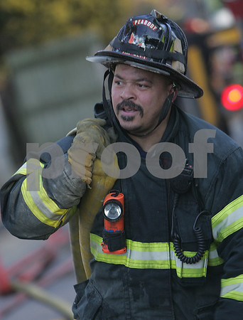 Peabody: James Kimber from the Peabody Fire Department gathers a line of hose while cleaning up the scene of a Warren Street fire on Tuesday afternoon. Photo by Matthew Viglianti/Staff Photographer Tuesday, February 17, 2009.