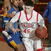 Salem: Salem sophomore Kyle Reardon dribbles around defensive pressure from East Boston freshman Andre Seniors during the second quarter of the Witche's home state tournament game on Wednesday. Salem fell to East Boston 66-58. Photo by Matt Viglianti/Salem News Wednesday, February 25, 2009