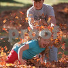 Danvers: Jennalynn Kennison, 7, of Danvers shrieks as her brother Collin Butler, 12, dumps a handful of leaves on his sister as the two play outside the Peabody Institute Library in Danvers on Monday afternoon. Collin was visiting the library to pick up a book for a class report. Photo by Matt Viglianti/Salem News Monday, October 20, 2008