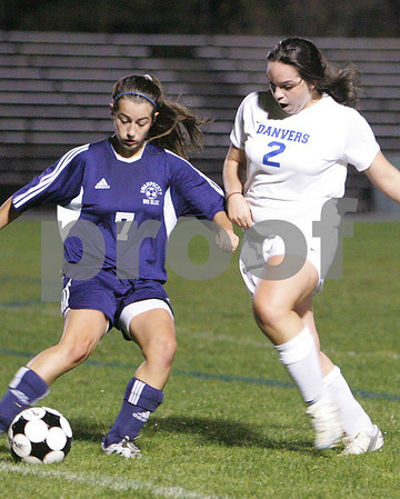 Danvers: Swampscott sophomore Lisa Gambale, left, gets a pass away while under pressure from Danvers junior Allie Lea during the second half of their game in Danvers on Wednesday. Photo by Matt Viglianti/Salem News Wednesday, October 15, 2008