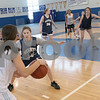 Swampscott: The Swampscott girls basketball team runs through a series of plays during practice on Thursday. The team is preparing for the state championship game in Worcester on Saturday. Photo by Matthew Viglianti/Staff Photographer Thursday, March 12, 2009.