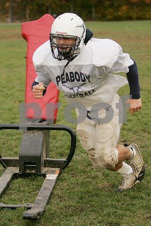 Peabody: Kevin Bettencourt sprints towards a tackling dummy after pushing a sled during practice with the Peabody High School football team on Wednesday. Photo by Matt Viglianti/Salem News Wednesday, October 29, 2008
