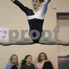 Marblehead: A woman and two young girls watch as Amanda Gretchell from Marblehead leaps off the floor during her floor routine at Marblehead's gymnastics meet against Hamilton-Wenham in Marblehead on Thursday. Gretchell scored a 9.4 for her performance. Photo by Matthew Viglianti/Staff Photographer Thursday, January 15, 2009.