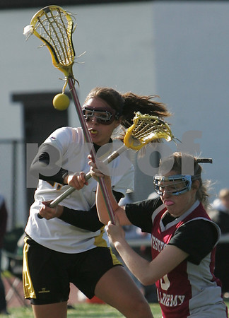Peabody: Bridget Dullea, senior captain for the Bishop Fenwick girls lacrosse team, fires a first half shot for a goal after beating Westford Academy junior Caroline Turpin, right, during their teams' state tournament game in Peabody on Tuesday. Fenwick, the number one seed in Division 2 North, lost the game. Photo by Matthew Viglianti/Staff Photographer Tuesday, May 26, 2009.