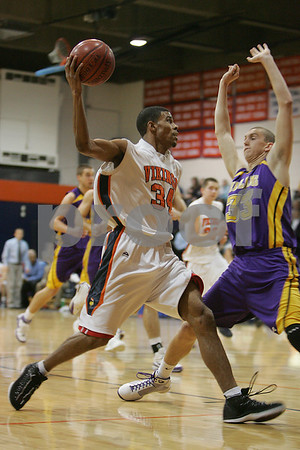 Salem: Salem State senior captain Ricky Ogboin drives the baseline against Williams College freshman Jordan Mickens during the championship game between the two schools at the Salem State College Christmas Tournament on Tuesday. Photo by Matthew Viglianti/Staff Photographer Tuesday, December 30, 2008.