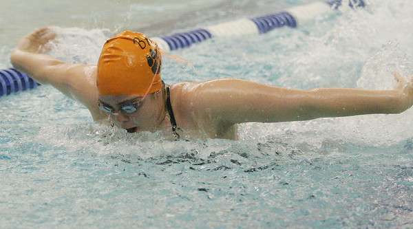 Peabody: Meghan Nardella swims the butterfly for the Beverly Panthers during their meet against Peabody at the Peabody-Lynn YMCA on Thursday night. Photo by Matthew Viglianti/Staff Photographer Thursday, December 17, 2009.