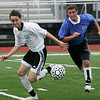 Lynn: Michael Collins from Salem, left, races to head off Carmen Bordonaro of Saugus from the ball during the 15th Agganis All-Star Men's Soccer Classic in Lynn on Tuesday. Photo by Matthew Viglianti/Staff Photographer Tuesday, July 7, 2010.