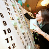 Salem: Kathie Walsh, a volunteer on the raffle committee for the Boys and Girls Club of Greater Salem, works a reverse raffle at the Boys and Girls Club of Greater Salem Shamrock Sweepstakes fundraiser on Wednesday. Photo by Matthew Viglianti/Staff Photographer Wednesday, March 17, 2010.