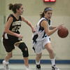 Peabody: Peabody freshman Hayley Dowd, right, races the ball up the court for the Tanners while under pressure from Gloucester's Heather Cain during the second half of their teams' game at the Peabody High School field house on Thursday night. Photo by Matthew Viglianti/Staff Photographer Thursday, January 28, 2010.