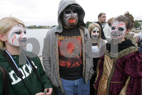 Salem: From left, Megan Condon, Jim Donlon, Dana Crescitelli, and Caitlin Condon, all from Beverly, hang out by the sea wall at Collins Cove Park while waiting for the start of the Zombie Walk through Salem on Sunday. Photo by Matt Viglianti/Salem News Sunday, October 05, 2008