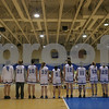 Danvers: The Danvers High School girls varsity basketball team joins hands during the playing of the National Anthem before the start of their home game against Beverly on Tuesday. Photo by Matthew Viglianti/Staff Photographer Tuesday, January 13, 2009.