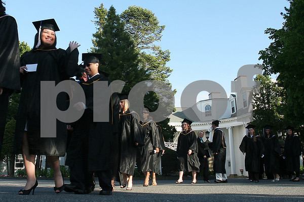 Swampscott: Students proceed into the tent for graduation ceremonies at the Marion Court College in Swampscott on Wednesday. 78 students graduated from the school, including 31 students from local towns. Photo by Matthew Viglianti/Staff Photographer Wednesday, May 20, 2009.