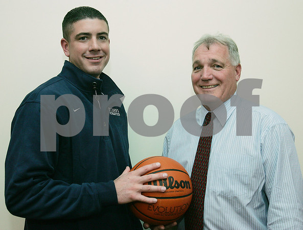 Danvers: Sean Connolly, left, poses with St. John's Prep Athletic Director Jim O'Leary after a press conference introducing Connolly as the Prep's new head basketball coach on Thursday evening. Connolly is leaving his alma mater, Bishop Fenwick, to take the position with the Prep. Photo by Matt Viglianti/Salem News Thursday, October 23, 2008