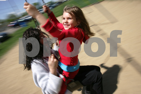 Peabody: Christine Potorski, 6, from Lebanon, ME joins her mother Jodi for a ride on the swings at the James Street Park in Peabody on Sunday afternoon. Photo by Matthew Viglianti/Staff Photographer Sunday, May 10, 2009.