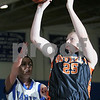 Danvers: Jen Ashton from Beverly lets loose a jump shot just before Danvers captain Bailey Potter reaches her to defend the shot during the second period of their teams' game in Danvers on Tuesday. Photo by Matthew Viglianti/Staff Photographer Tuesday, January 13, 2009.