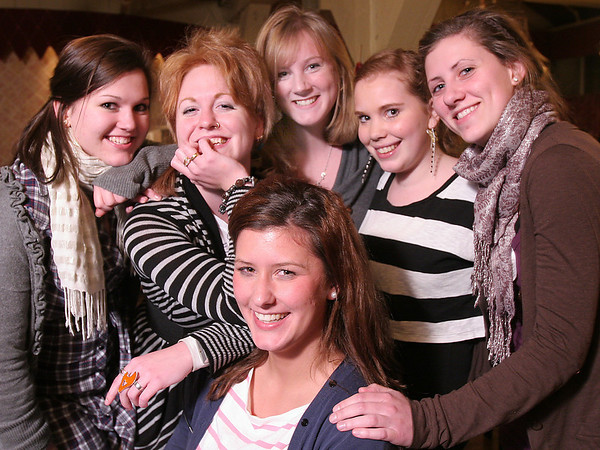 Saugus: From left to right, Lisa Hasse from Germany, Anna Ronngren from Sweden, Lina Andersson from Sweden, Denise Koehler from Germany, Leonie Kochen from Germany, and Ingrid Blomvik from Norway pose for a picture at Prince Pizza in Saugus, where a group of approximately 40 North Shore au pairs from around the world gathered on Wednesday night for a holiday party. Photo by Matthew Viglianti/Staff Photographer Wednesday, December 17, 2009.