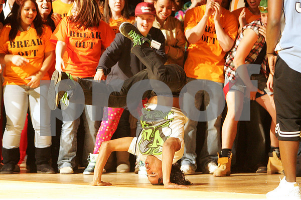Salem: Miguel Cruz performs a break dance routine while being surrounded by his peers on stage during the Class of 2009 Senior Show at the High School on Thursday. Money from the event benefits the senior class. Photo by Matthew Viglianti/Staff Photographer Thursday, March 12, 2009.