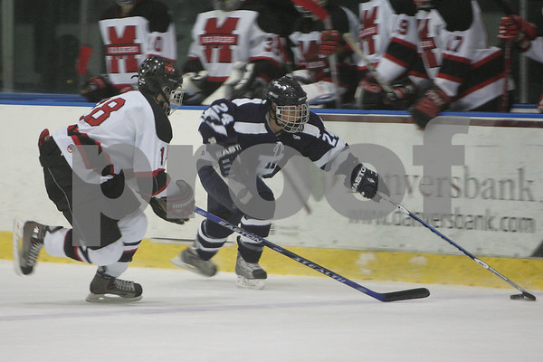 Salem: Derek Pereira from Peabody speeds past the Marblehead as Jay King from Marblehead moves in to play defense during the first period of their team's game in Salem on Wednesday. Photo by Matthew Viglianti/Staff Photographer Wednesday, January 14, 2009.