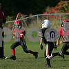 Salem: RJ Woodbury from Salem eyes an approaching Beverly defender while carrying the ball during a youth football game at Bertram Field in Salem on Sunday. Photo by Matthew Viglianti/Staff Photographer Sunday, October 12, 2008.