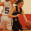 Melrose: Sarah James, a Bishop Fenwick junior, spins around Stoneham senior Marisa Cataldo during the third quarter of the Division 3 North semifinal game in Melrose on Wednesday. James scored 10 points to help Fenwick capture a 53-49 victory and advance to the next round of the playoffs. Photo by Matthew Viglianti/Staff Photographer Wednesday, March 3, 2010.
