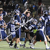 Cambridge: The St. John's Prep lacrosse team celebrates after beating Duxbury 12-11 for the Division 1 state championship at Harvard Stadium in Cambridge on Wednesday night. The Prep won on a sudden death overtime goal by senior James Fahey. Photo by Matthew Viglianti/Staff Photographer Wednesday, June 16, 2010.