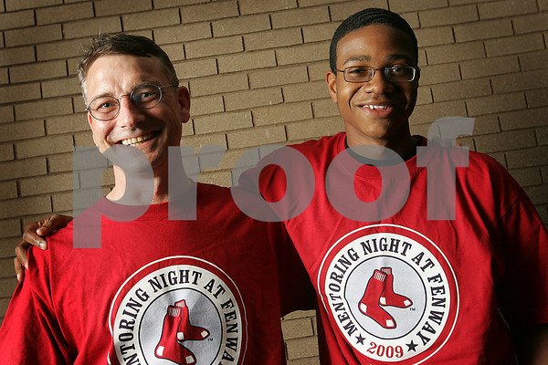 Beverly: Beverly residents James Monahan, left, and Christopher Thomasson, 17, are participating in the first pitch ceremony before the Red Sox game on Thursday. The pair were matched by the Mass Mentoring Partnership, and have been awarded by the statewide association as an outstanding mentor match. Photo by Matthew Viglianti/Staff Photographer Tuesday, May 5, 2009.