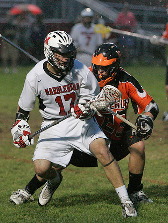 Marblehead: Alex Whitmore from Marblehead, left, shields the ball away from Will Brown of Beverly during the fourth quarter of their game in Marblehead on Wednesday. Beverly won the game 8-6 to win the NEC championship. Photo by Matthew Viglianti/Staff Photographer Wednesday, May 26, 2010.