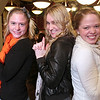 "Saugus: From left to right, Lisa Scadden, Blaire Martin, and Sara Torkelson do their best ""Charlie's Angels"" impression at a dinner for North Shore au pairs on Wednesday night. Scadden and Martin are from Australia, while Torelson hails from Sweden. About 40 au pairs from around the world gathered for pizza and gift swaps."